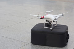 A unmanned aerial vehicle or drone. With a camera mounted on bag stock photo