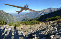 Unmanned Aerial Vehicle drone in flight. With mountains in background Royalty Free Stock Photos