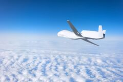 Free Unmanned Aerial Vehicle Flying High In The Sky Above The Clouds, Mission. Elements Of This Image Furnished By NASA. Royalty Free Stock Photography - 180169027