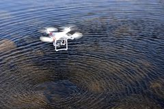An unmanned aerial vehicle. Made in China flying on the surface of the water royalty free stock photos