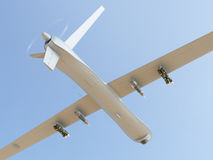 Unmanned aerial vehicle in the sky. Military unmanned aerial vehicle (UAV) with missiles in the sky Stock Image
