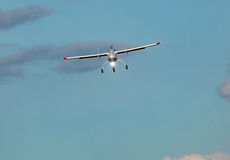 Unmanned aerial vehicle UAV in blue sky. White Unmanned aerial vehicle UAV in blue sky Royalty Free Stock Photography
