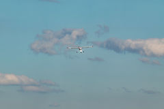 Unmanned aerial vehicle UAV in blue sky. White Unmanned aerial vehicle UAV in blue sky Royalty Free Stock Photos