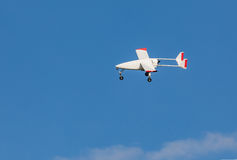 Unmanned aerial vehicle UAV in blue sky. White Unmanned aerial vehicle UAV in blue sky Stock Photo