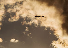 Unmanned aerial vehicle UAV in the sky. In sunset Stock Images