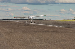 Unmanned aerial vehicle UAV starts from the asphalt runway. White Unmanned aerial vehicle UAV starts from the asphalt runway Stock Photo