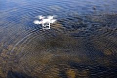 An unmanned aerial vehicle. Made in China flying on the surface of the water royalty free stock photography