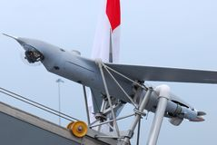 Unmanned aircraft. An unmanned aerial military aircraft on its launching platform at display stock photo