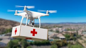 Unmanned Aircraft System UAS Quadcopter Drone Carrying First Aide Kit. Unmanned Aircraft System UAS Quadcopter Drone Carrying First Aid Package Over Neighborhood Royalty Free Stock Images