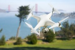 Unmanned Aircraft System UAV Quadcopter Drone In The Air Near Stock Images