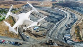 Unmanned Aircraft System UAV Quadcopter Drone In The Air Over. Construction Site stock image