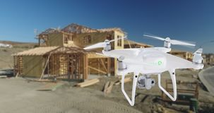 Unmanned Aircraft System UAV Quadcopter Drone In The Air Over. A Home Construction Site Stock Photo
