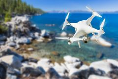 Unmanned Aircraft System UAV Quadcopter Drone In The Air Over. Lake Tahoe stock photo