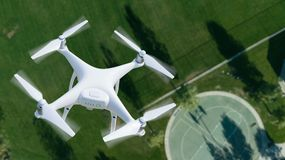 Unmanned Aircraft System UAV Quadcopter Drone In The Air Over. A Park Royalty Free Stock Image