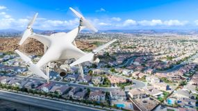 Unmanned Aircraft System UAV Quadcopter Drone In The Air Over. Residential Neighborhood Royalty Free Stock Image