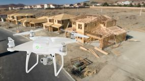 Unmanned Aircraft System UAV Quadcopter Drone In The Air Over. Construction Site Royalty Free Stock Images