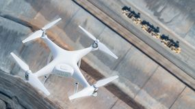 Unmanned Aircraft System UAV Quadcopter Drone In The Air Over. Construction Site Stock Photos