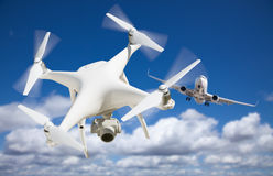 Unmanned Aircraft System UAV Quadcopter Drone In The Air Too C. Lose To Passenger Airplane stock photography