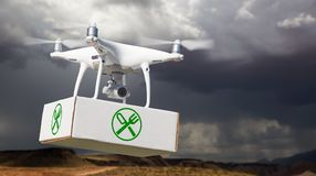 Unmanned Aircraft System UAV Quadcopter Drone Carrying Package. With Food Symbol Label Near Stormy Skies stock photo