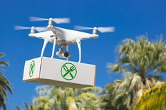 Unmanned Aircraft System UAV Quadcopter Drone Carrying Package. With Food Symbol Label Over Tropical Terrain Stock Photography