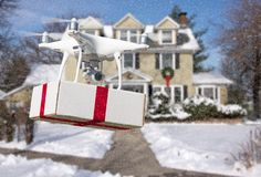 Unmanned Aircraft System UAV Quadcopter Drone Delivering Gift stock photos
