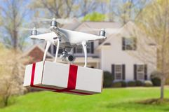 Unmanned Aircraft System UAV Quadcopter Drone Delivering Gift stock images