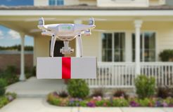 Unmanned Aircraft System UAV Quadcopter Drone Delivering Gift stock image
