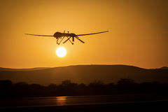 An unmanned drone low pass in sunset. Unmanned air vehicle for air to ground surveillance royalty free stock photo