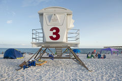 Unmanned lifegaurd station at Pensacola Beach Florida. An unmanned lifeguard station overlooking the sugar white sands of Pensacola Beach as beach goers are Stock Photography