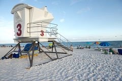 Unmanned lifeguard station at Pensacola Beach, Florida. An unmanned lifeguard station overlooking the sugar white sands of Pensacola Beach as beach goers are royalty free stock photo