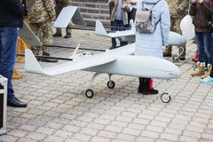Unmanned military aircraft. At people competition background Royalty Free Stock Photos