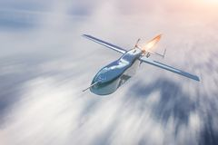 Unmanned military drone flying over cloudscape, motion blur speed.  stock photos
