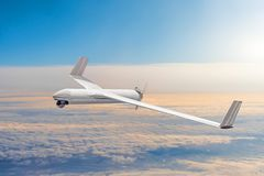 Unmanned military drone on patrol air territory at high altitude. Unmanned military drone on patrol air territory at high altitude royalty free stock photos