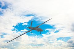 Unmanned military drone on patrol air territory at high altitude. Unmanned military drone on patrol air territory at high altitude stock images
