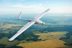 Unmanned military drone on patrol air territory at low altitude. Unmanned military drone on patrol air territory at low altitude stock photos