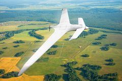 Unmanned military drone on patrol air territory at low altitude. Unmanned military drone on patrol air territory at low altitude stock photography