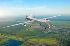 Unmanned military drone on patrol air territory at low altitude. Unmanned military drone on patrol air territory at low altitude royalty free stock images