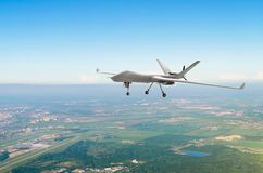 Unmanned military drone uav on patrol air territory at low altitude. Unmanned military drone uav on patrol air territory at low altitude royalty free stock photos
