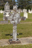 An unmarked grave with a metal cross. Stock Images