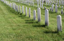 Unmarked Graves. White toombstones marking graves without text Stock Photos