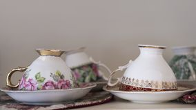 Unmatched bone china porcelain tea cups and saucers stock photo