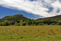 The unmistakable shape of Colle Rousse, Volcanic plug across the fields and meadows of La Plan, Bagnols. En Foret, The Var, France Royalty Free Stock Images