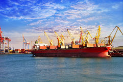 Unmoor. Departure of the cargo ship in the port Royalty Free Stock Photo