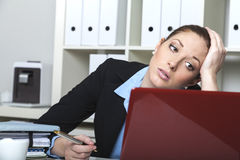 Unmotivated woman at her desk Royalty Free Stock Photography