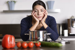 Unmotivated woman preparing the dinner Royalty Free Stock Photos