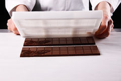 Unmoulding chocolate bars Royalty Free Stock Images