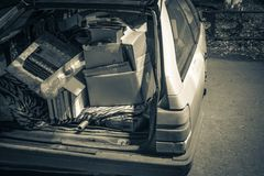 Unnecessary garbage carried in the trunk of an old car royalty free stock photo