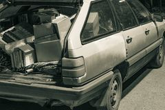 Unnecessary garbage carried in the trunk of an old car royalty free stock photography