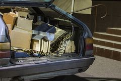 Unnecessary garbage carried in the trunk of an old car stock image