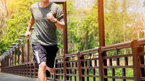 Unning man. Male runner at sprinting speed training for marathon. Outdoors Stock Photo